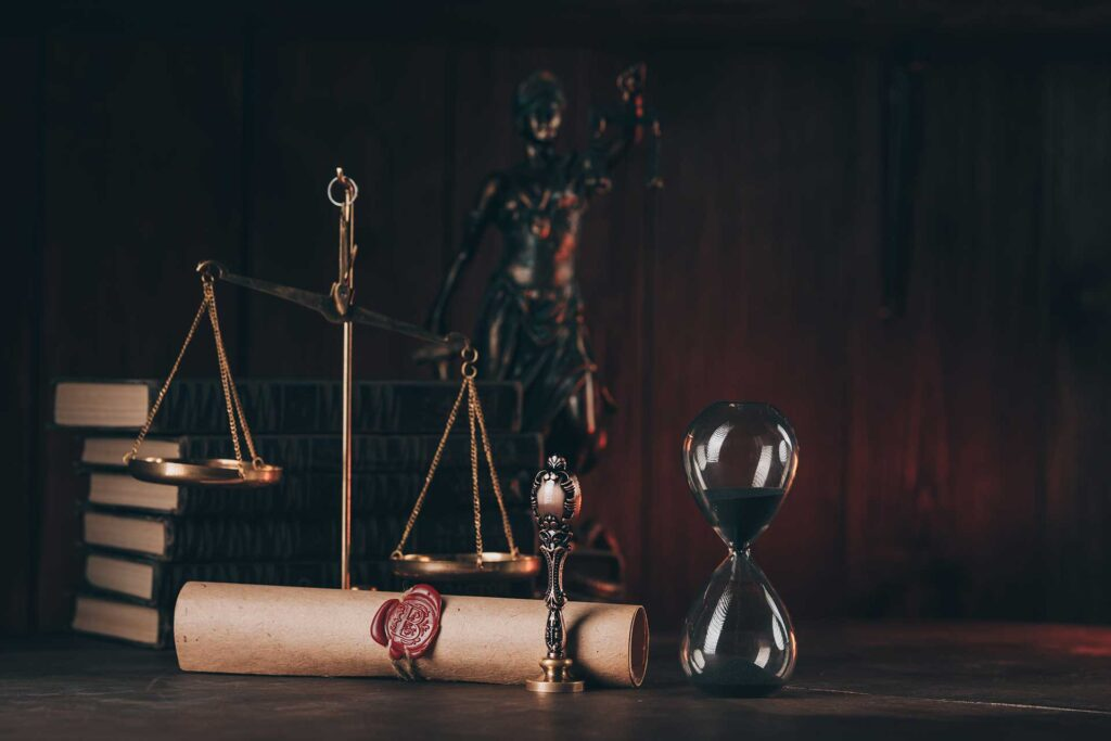 Scales of Justice and hourglass